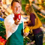 kozzi-27472480-Man_in_supermarket_as_shop_assistant-300